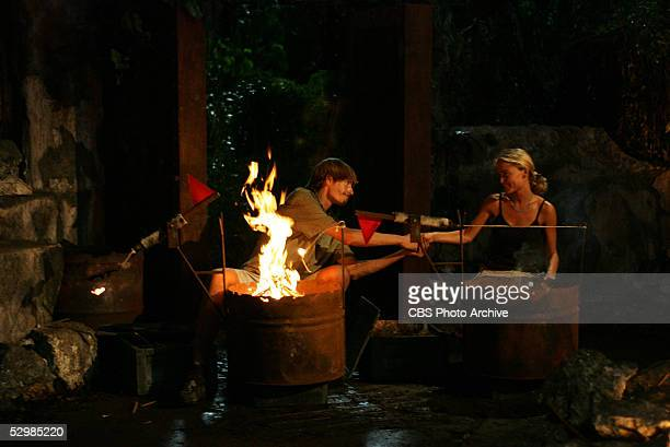 Castaways Ian Rosenberger and Jennifer Lyon of the Koror tribe at tribal council during a tie breaker in the final episode of Survivor Palau