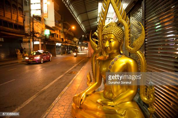 Casted Buddha statue on the pavement, Bangkok Thailand