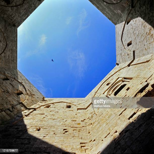 Casteldelmonte Central Courtyard, attributed by Federico II Emperor 1. Castel del Monte is a 13th-century citadel and castle located on a hill in...