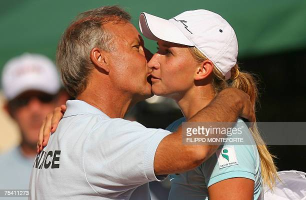 Kiss the coach stock photos and pictures getty images french tatiana golovin kisses her coach georges goven after defeating italian tathiana garbin during the fed m4hsunfo