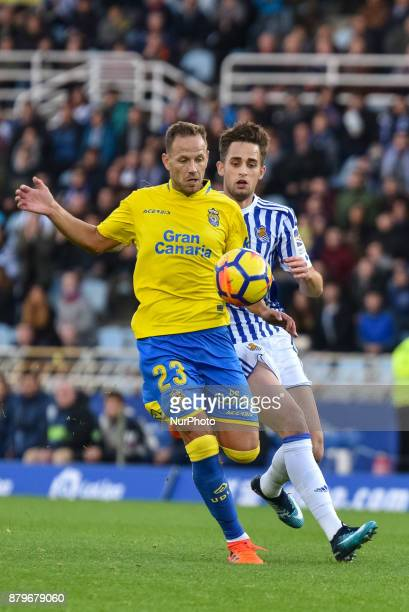 D Castellano of U D Las Palmas duels for the ball with Adnan Januzaj of Real Sociedad during the Spanish league football match between Real Sociedad...
