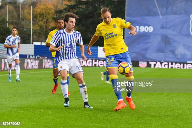 D Castellano of U D Las Palmas duels for the ball with Alvaro Odriozola of Real Sociedad during the Spanish league football match between Real...