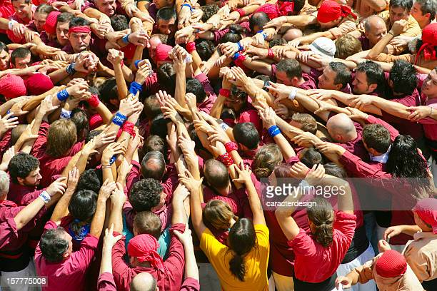 castellers: building a human castle - castellers stock photos and pictures