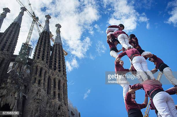 Castellers de la Vila di Gracia do their show in front of La Sagrada Familia in Barcelona on April 17 2016 Castells are a 200yearsold Catalan...