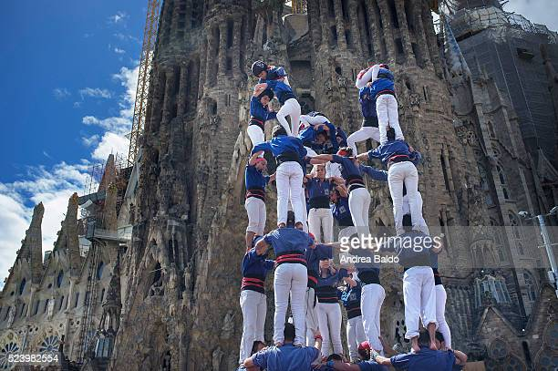 Castellers do their show in front of La Sagrada Familia in Barcelona on April 17, 2016. Castells are a 200-years-old Catalan mainstream folklore and...