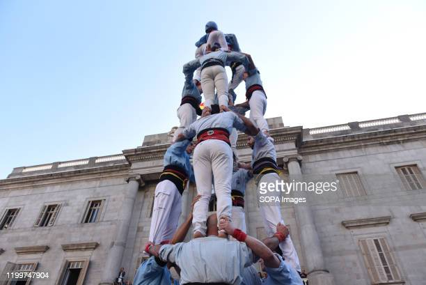 Castellers form a castel, a human tower, seen during the Santa Elulalia festival in Barcelona. These human towers are built traditionally during the...