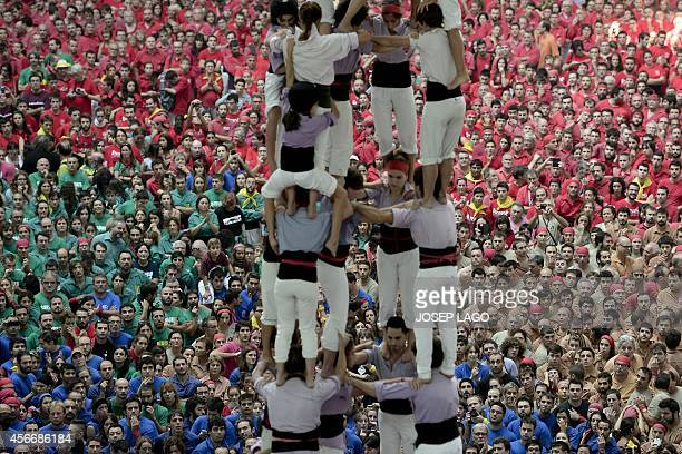 'Castellers ' form a tower during the XXV human towers or castells competetion in Tarragona on October 35 2014 These human towers built traditionally...