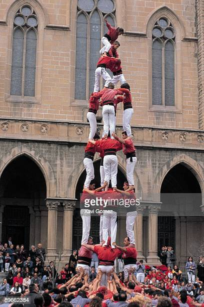 Castellers forming a castle A castellers group tries to form a human castle in a square of Catalonia