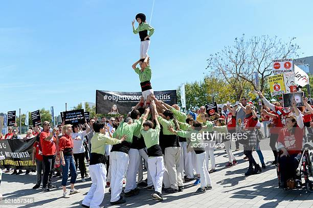 'Castellers' make a human tower during a demonstration called by several organizations and people affected by th hepatitis C virus demanding the need...