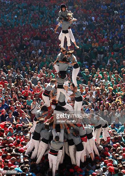 Castellers of the Castellers de Sants 'colle' fall down while building a human tower during the 22nd Tarragona Castells Competition on October 5 2008...