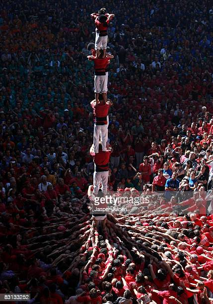 Castellers of the Colla Jove Xiquets de Tarragona 'colle' build a human tower during the 22nd Tarragona Castells Competition on October 5 2008 in...