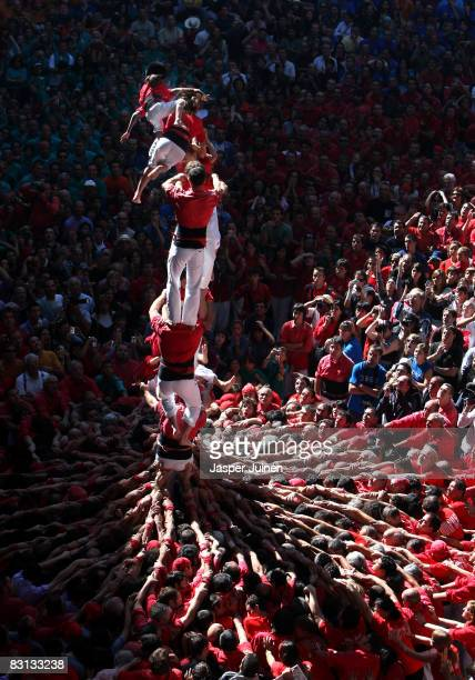 Castellers of the Colla Jove Xiquets de Tarragona 'colle' fall down while building a human tower during the 22nd Tarragona Castells Competition on...