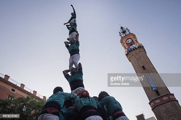 GRACIA BARCELONA CATALUNYA SPAIN Castellers perform their show over the week of Festa Major de Gracia in Plaza de la Vila de Gracia in Barcelona...