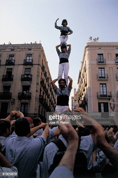 Castellers training A castellers group tries to form a human castle in a square of Barcelona