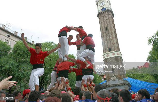 Castellier leaves a human tower during the 'Fiesta Major de Gracia' on August 17 2003 in Barcelona Spain This Catalan tradition has been practiced...