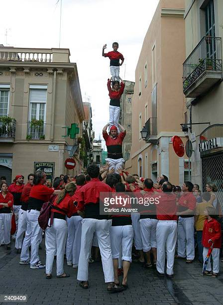 'Castelliers' form a human tower during the 'Fiesta Major de Gracia' on August 17 2003 in Barcelona Spain This Catalan tradition has been practiced...