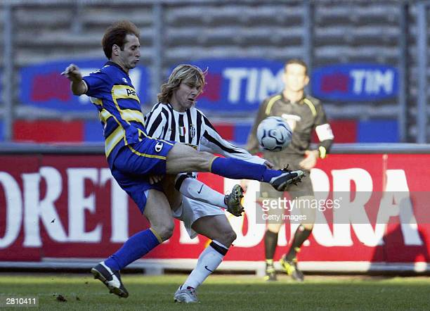 Castellini of Parma challenges Pavel Nedved of Juventus during the Juventus v Parma Serie A match played at the Delle Alpi Stadium December 14 2003...