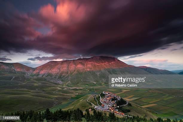 castelluccio and top of redeemer - castelluccio stock photos and pictures