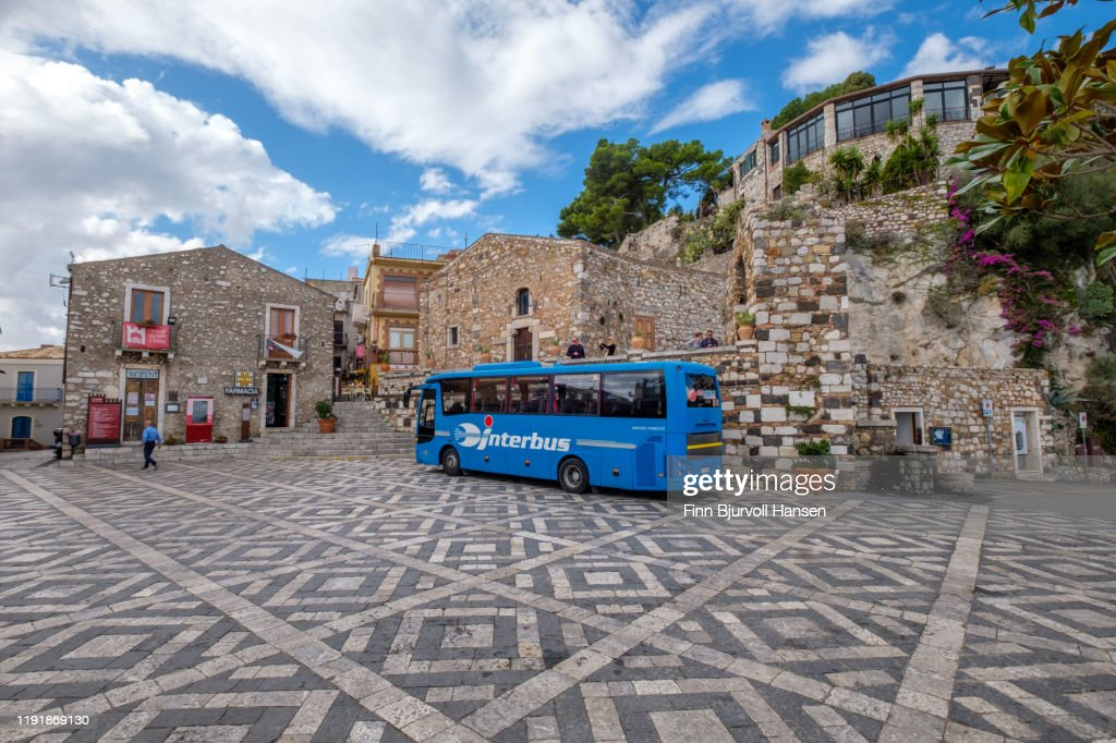 Castelmola Sicily - November 8, 2019/ Local bus from Interbus at the Piazza S. Antonio in Castelmola Sicily Italy. : Stock Photo