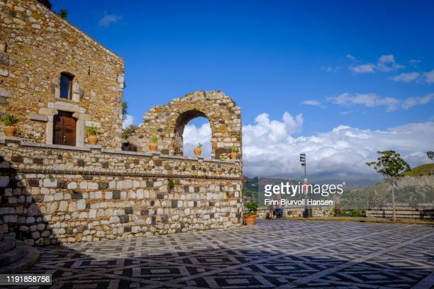 castelmola,taormina,sicily - november 8, 2019 - piazza s. antonio - finn bjurvoll stock photos and pictures