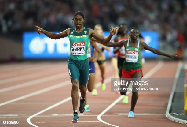 Caster Semenya of South Africa celebrates as she crosses the line ahead of Francine Niyonsaba of Burundi to win the Womens 800 metres during day ten...