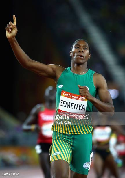 Caster Semenya of South Africa celebrates as she crosses the line to win gold in the Women's 800 metres final during athletics on day nine of the...