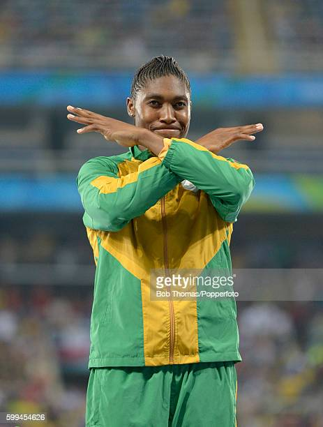 Caster Semenya of South Africa celebrates on the podium before the medal ceremony for the Women's 800m Final on Day 15 of the Rio 2016 Olympic Games...