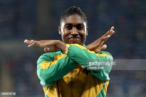 Caster Semenya of South Africa celebrates on the podium during the medal ceremony for the Women's 800 meter Final on Day 15 of the Rio 2016 Olympic...