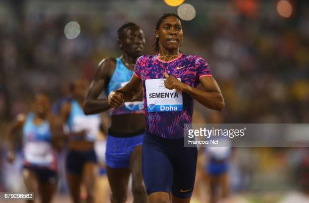 Caster Semenya of South Africa crosses the line to win the Women's 800 metres during the Doha IAAF Diamond League 2017 at the Qatar Sports Club on...