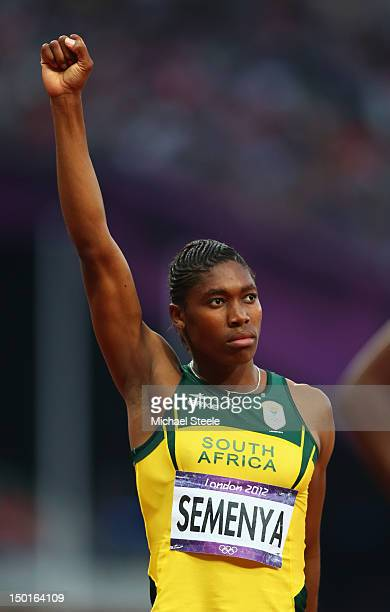 Caster Semenya of South Africa raises her fist before competin in the Women's 800m Final on Day 15 of the London 2012 Olympic Games at Olympic...