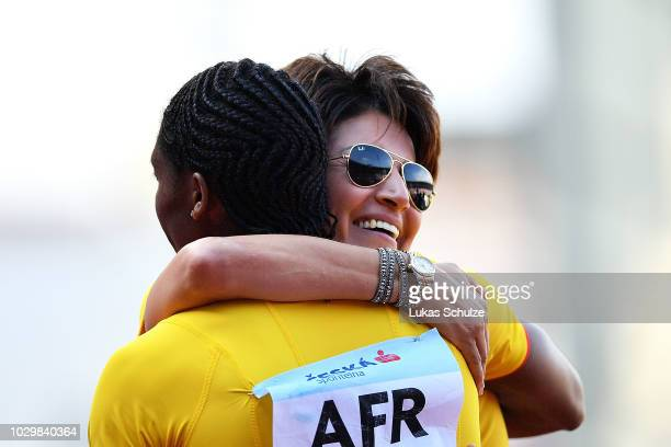 Caster Semenya of Team Africa celebrates victory with Team Africa Ambassador Nezha Bidouane following the Womens 800 Metres during day two of the...