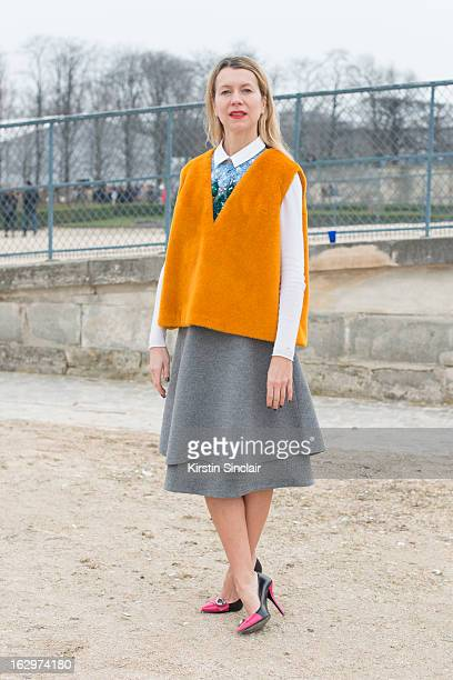 Casting agent Natalie Joos wears a J Crew sweater Prada shoes Vika Gazinskaya dress and top on day 2 of Paris Womens Fashion Week Autumn/Winter 2013...
