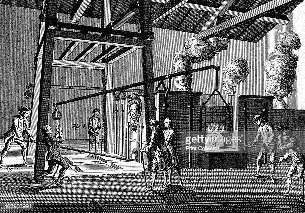 Casting cannon, 1751-1780. A furnace is being tapped to allow molten metal to run into the moulds at the feet of the workmen on the left. On the...
