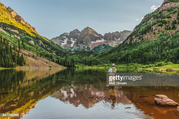casting in the wilderness - maroon bells stock photos and pictures