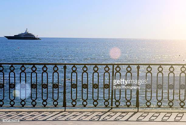 Cast-iron balustrade overlooking the sea in Giardini Naxos, near Taormina, Sicily, Italy