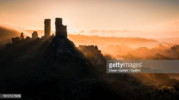 castle against sky during sunset - ancient civilization stock pictures, royalty-free photos & images