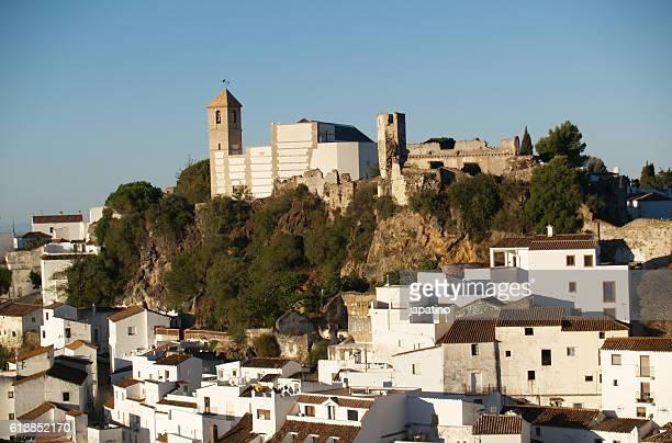 castle and church on top of the village of casares in malaga. andalusia - indigo casares fotografías e imágenes de stock