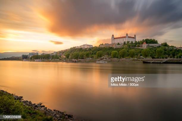 castle and river at sunset, bratislava, slovakia - bratislava stock pictures, royalty-free photos & images