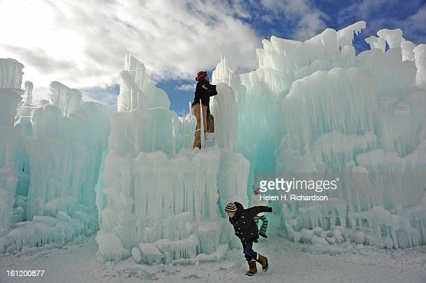 Castle builder Dan Beck places recently harvested icicles onto the ever expanding ice palace The icicles are made nightly using wire mesh and water...