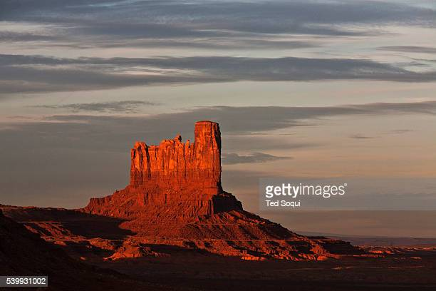 Castle butte inside the Monument Valley Tribal Park at sunset The parked is owned and operated by the Navajo people