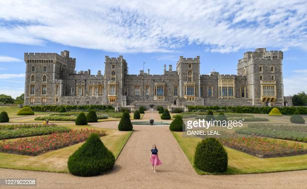 Castle employees pose during a photocall in the East Terrace Garden at Windsor Castle in Windsor on August 5, 2020. - The East Terrace Garden at...