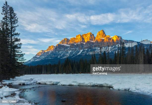 castle mountain at sunset, banff national park, alberta canada - castle mountain stock photos and pictures