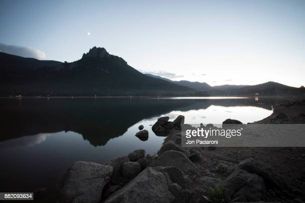 Castle Mountain reflected in a calm mirror-like lake