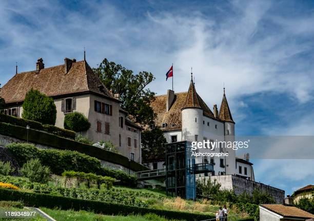 castle of nyon with tourists. - nyon stock pictures, royalty-free photos & images