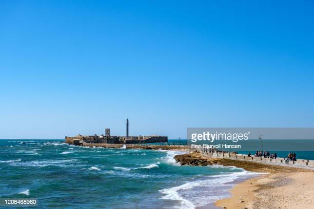 castle of san sebastian and lighthouse - finn bjurvoll stock pictures, royalty-free photos & images
