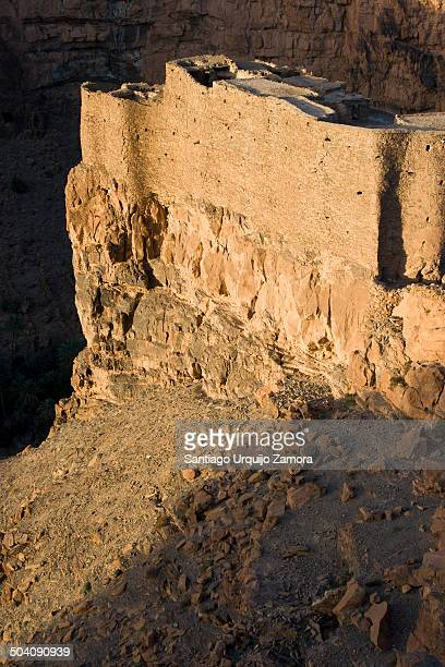 CONTENT] Castle on a cliff over the Berber oasis of Amtoudi bathed in the early morning light SoussMassaDraa Morocco