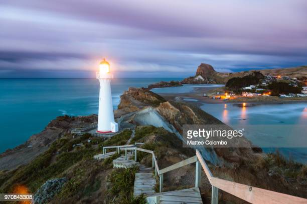 castle point lighthouse at dawn, wellington region, new zealand - wellington new zealand stock photos and pictures