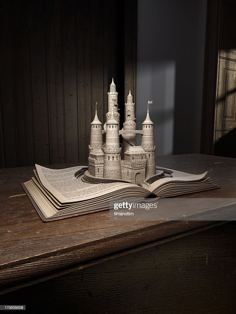 Castle popping up from an old book : Stock Photo