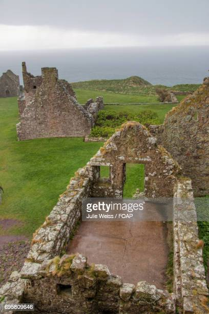 castle ruins in the rain - dunnottar castle stock pictures, royalty-free photos & images