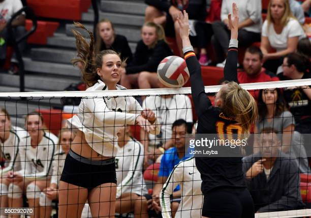 Castle View Genna RyanPlasecki blocks a shot by Mountain Vista Amanda Keller on September 19 2017 during their volleyball game in Castle Rock